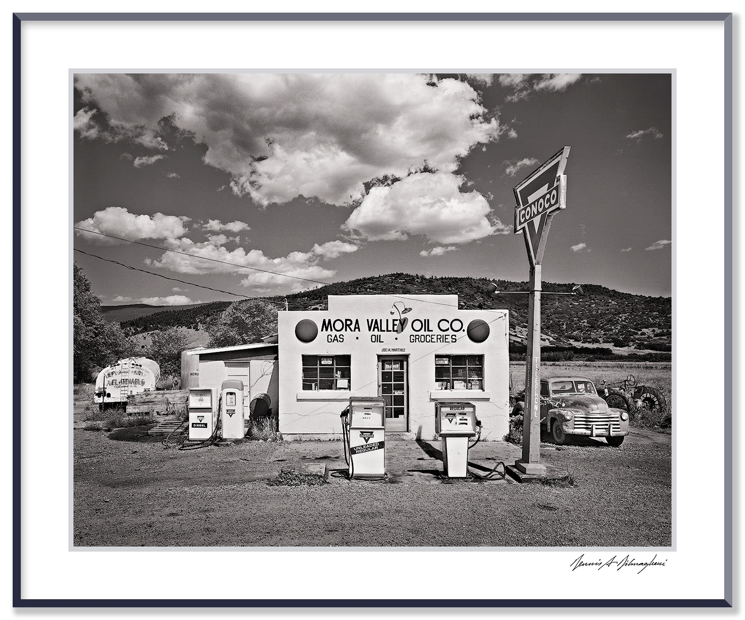 """Mora Valley Oil Company - Cleveland, New Mexico   This scene in the heart of Mora Valley, New Mexico, glowed in the early afternoon sun with down-home Americana spirit.  Vintage building, classic style gas pumps, trucks, tractor, big sky... The granddaughter of the original gas station owner found the image on the internet and wrote to me, """"Thank you for taking this photo. It brought a tear of joy to see something so dear to my family as it used to be in the """"good old days""""."""