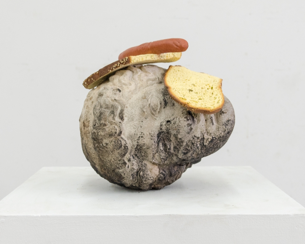 Tony Matelli  -  Head (Hot Dog and Bread) , 2018 Cast stone and painted bronze 11h x 8/5w x 10d inches