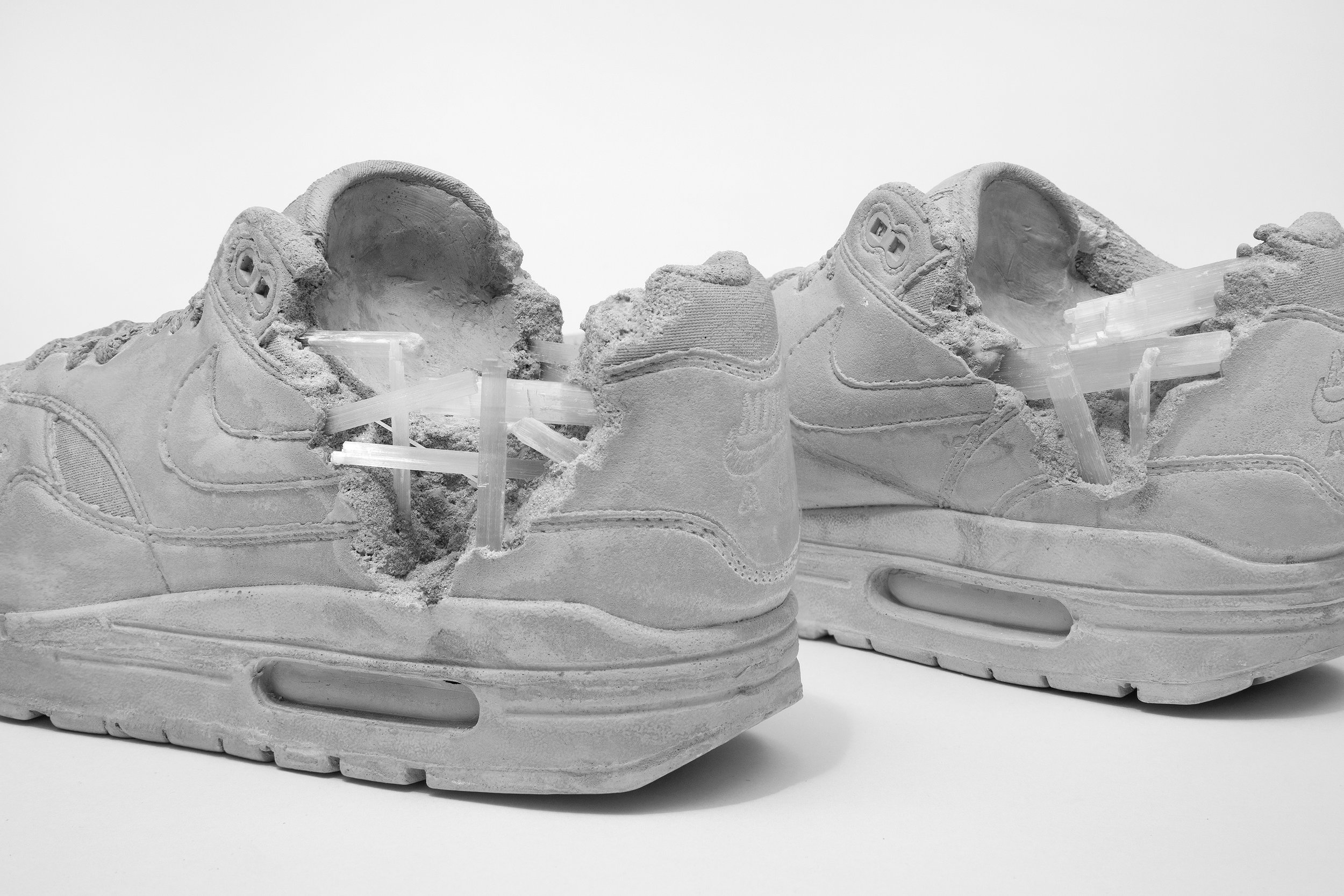 Daniel Arsham  - Grey Selenite Eroded Sneakers (Pair), 2019 Selenite, hydrostone, aluminum oxide 5 x 11.75 x 3.5 in. (each shoe)