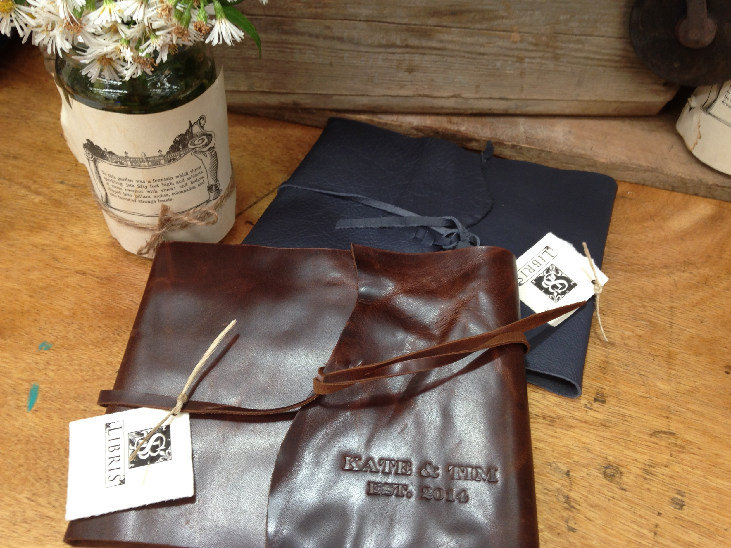 Wedding guest books in leather wrap style.