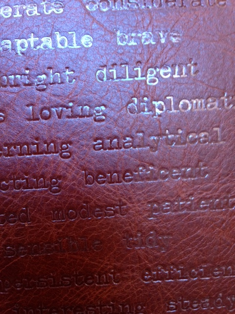 This custom binding featured a list of descriptive words embossed over the entire front of the full leather binding