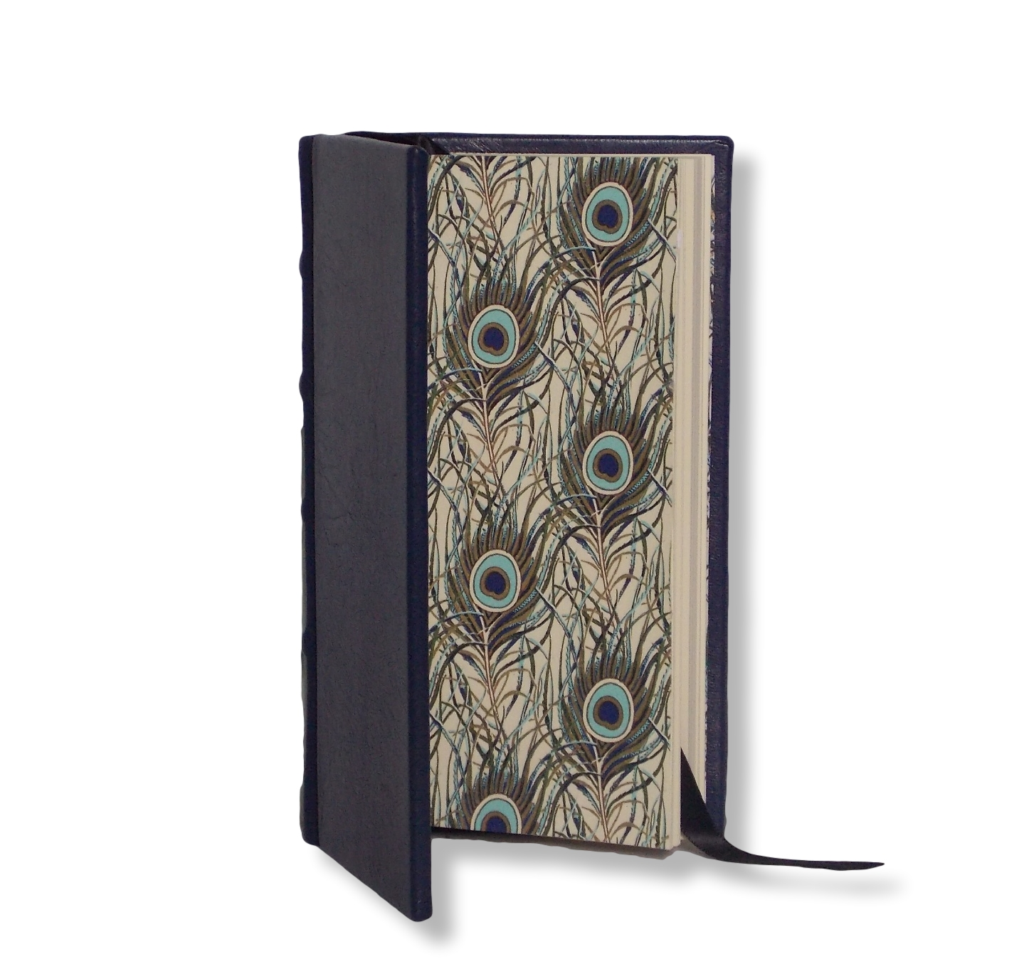 SLIMLINE LEATHER JOURNAL IN NAVY   A full navy leather bound cover with gold foiled peacock design end papers.   70 cream pages.   Classic raised bands on the spine.  Product dimensions: 17.5cm x 9.5cm  Perfect for personalisation with a name, date, initials or quotes