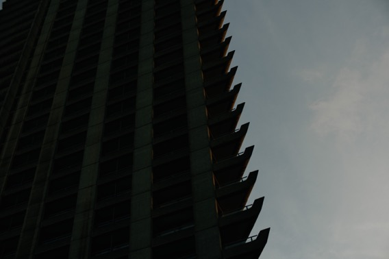 A high tower in silhouette.