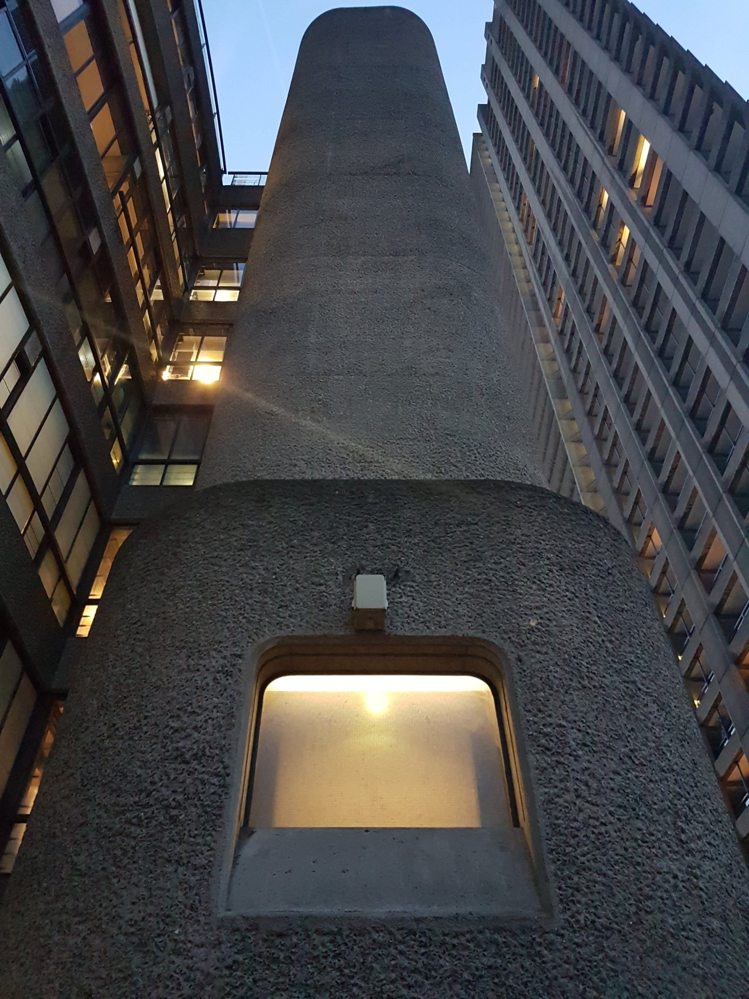 Details such as light fixtures and window frames were all custom designed for this project. The textured concrete walls were hand-drilled on the exterior and interior surfaces.
