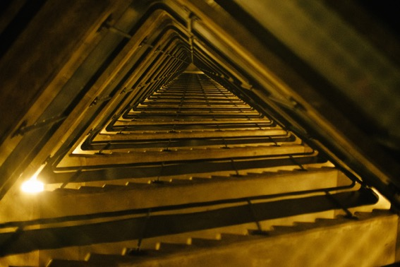 Looking up through the stairwell of the high tower.