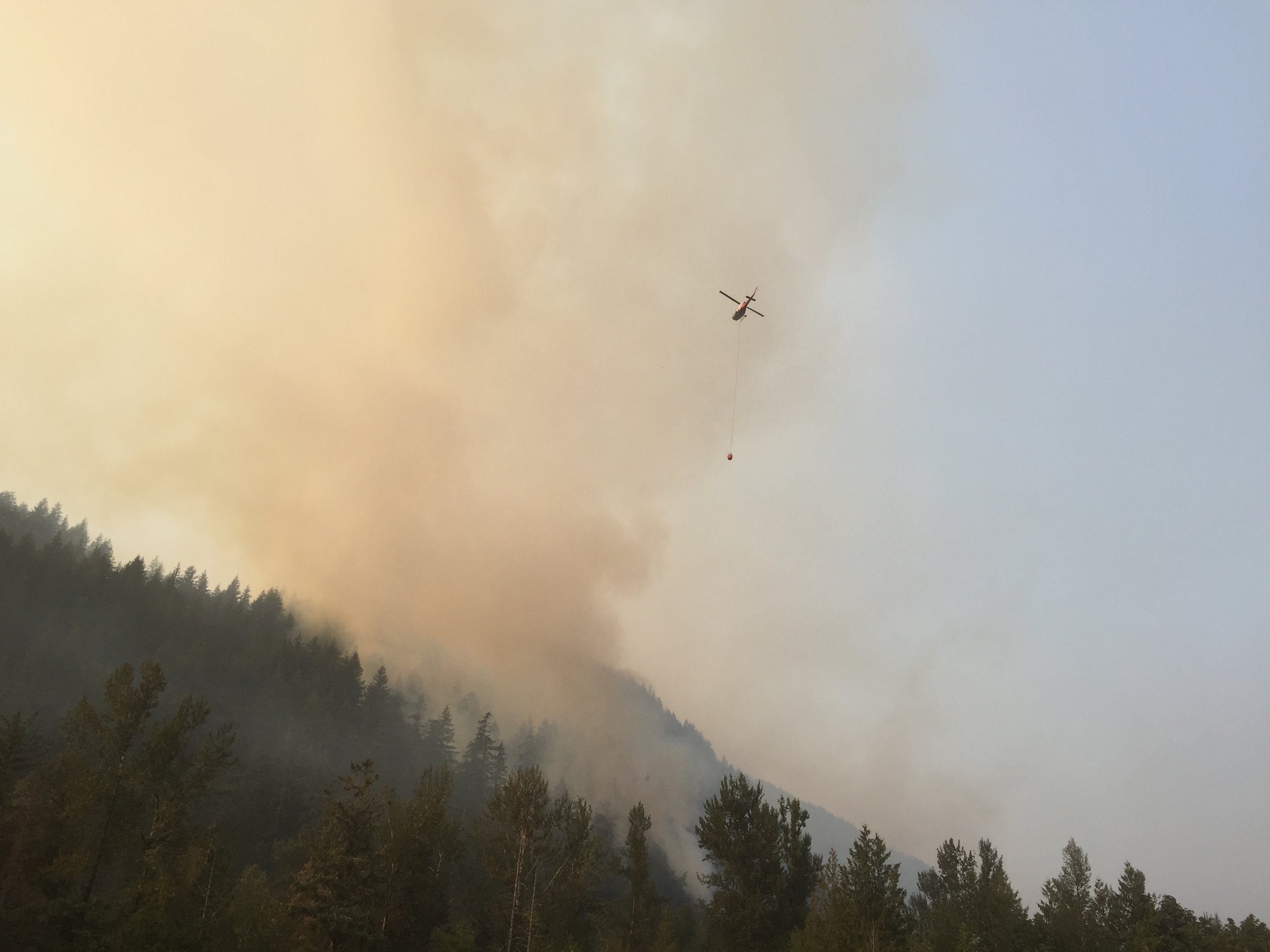 The seeming futility of human efforts against wildfires.