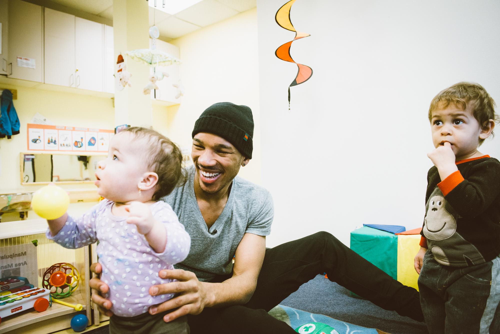Avery Bradley and infants from Horizons Homeless for Children