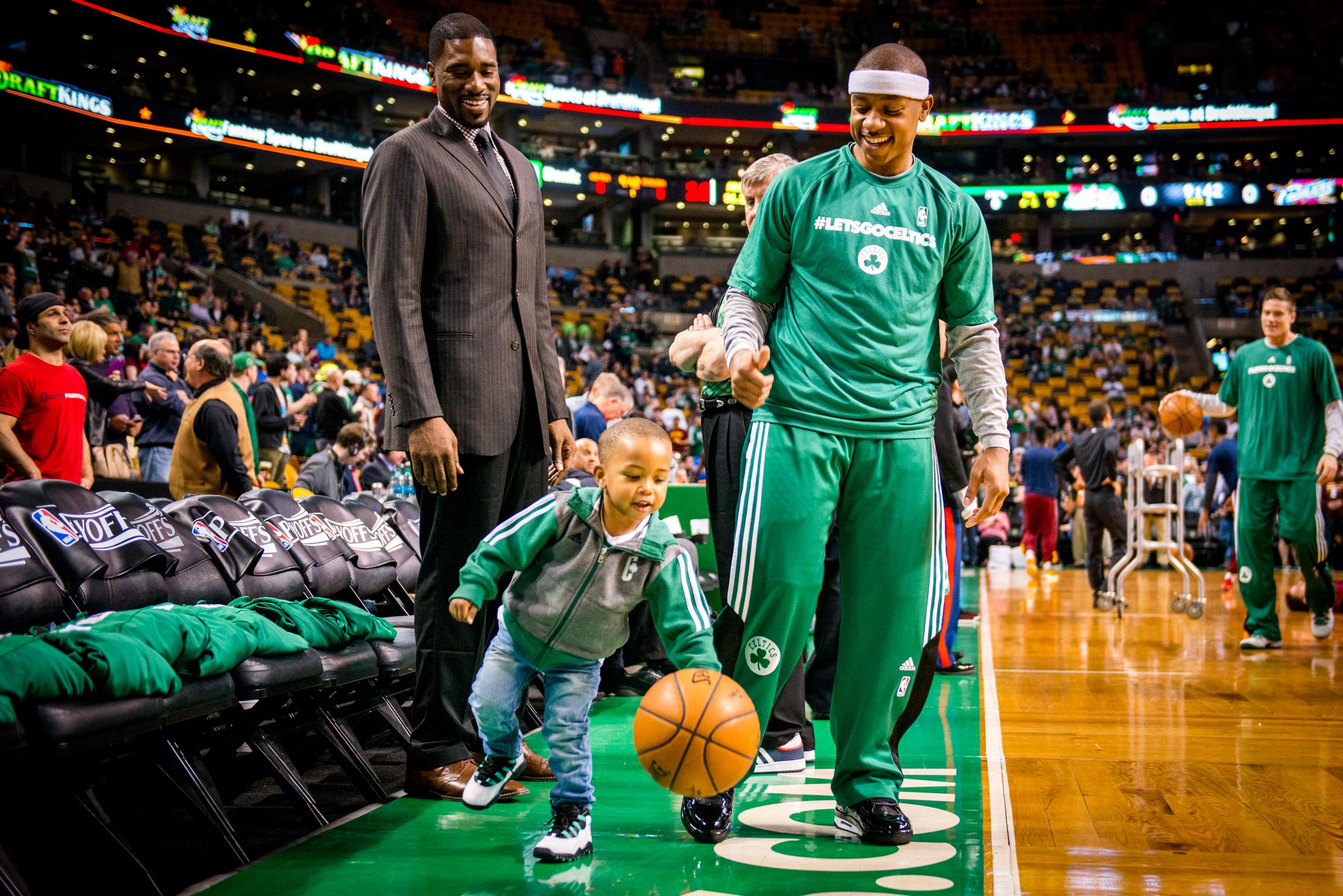 Celtics vs. Cavs   Game 4 Playoffs   Isaiah Thomas and his son alongside Leon Powe
