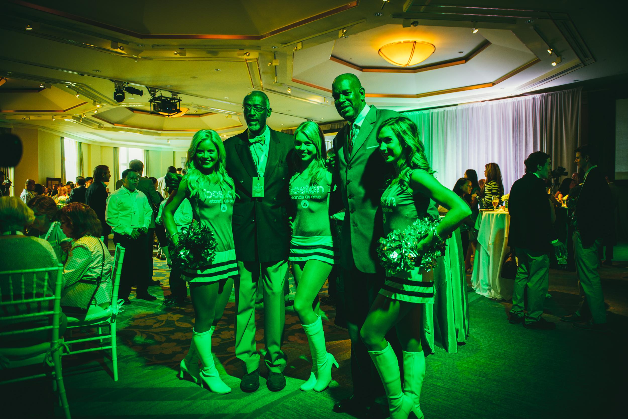 "Former Celtics Tom ""Satch"" Sanders and Cedric Maxwell with Celtics dancers"