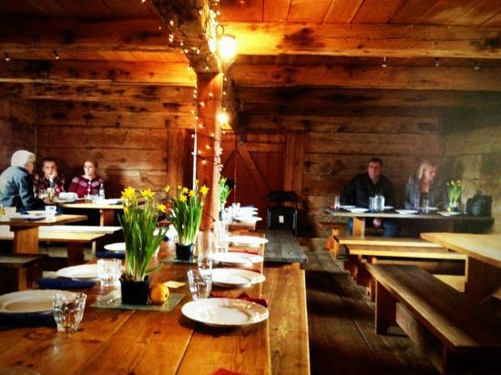 The cozy, rustic interior of the refurbished wooden warehouse that houses Tjouhusid / photo by evamaria4 via tripadvisor.com