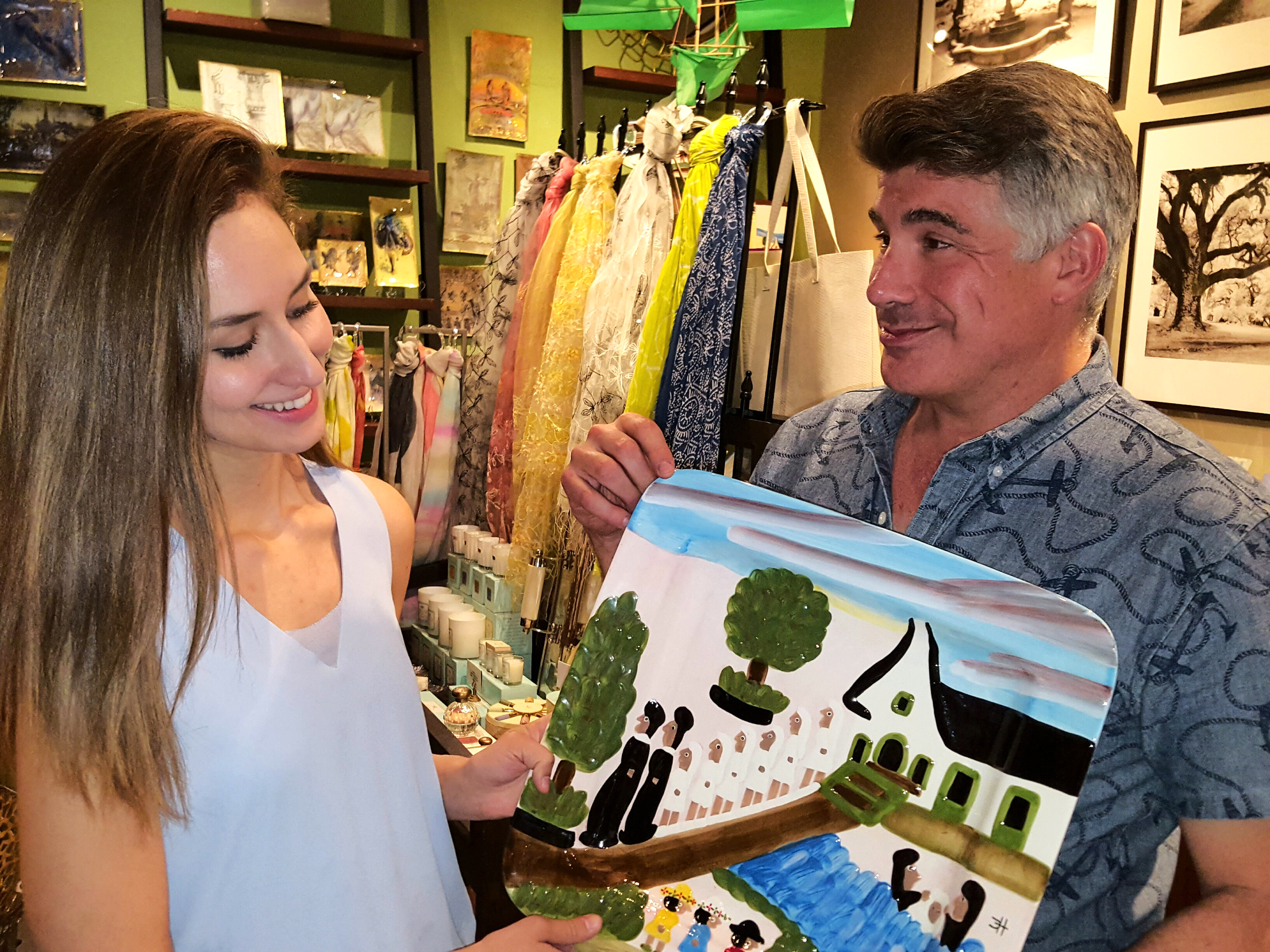 Batt shows off some new merchandise -- a majority of which is made by local New Orlean artists.