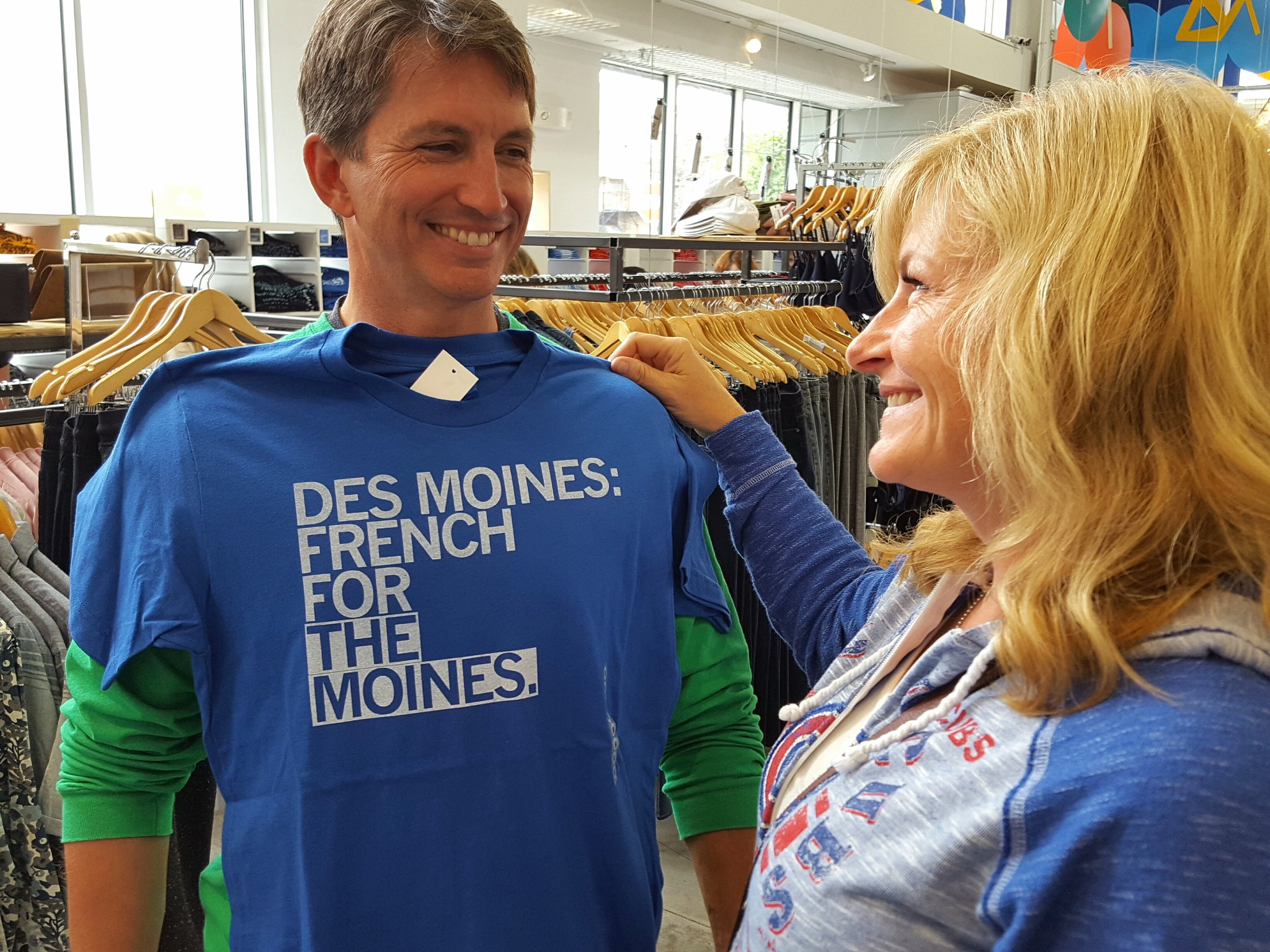 Heather Burnside picks out just the perfect shirt for a local Des Moines police officer.