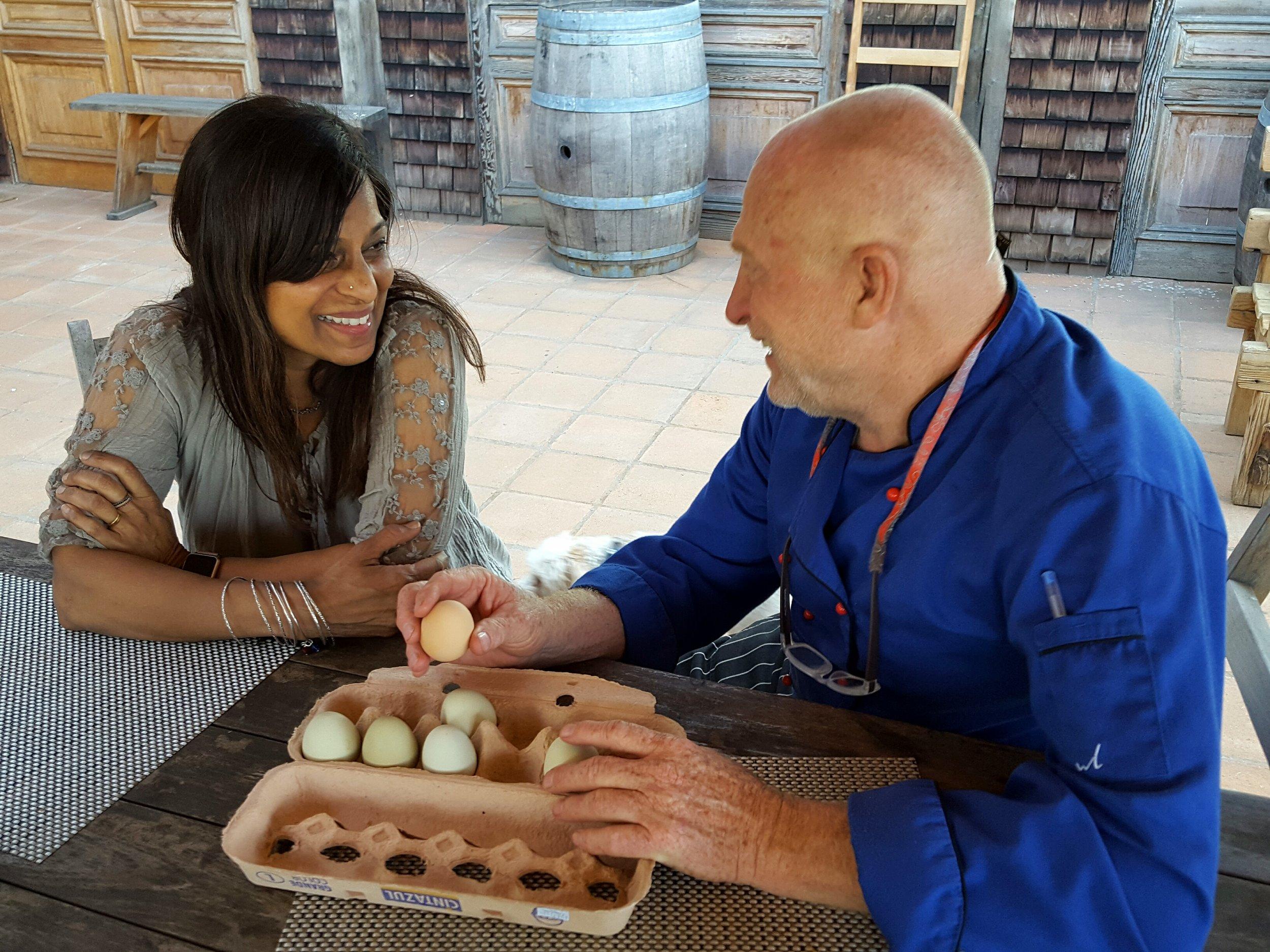Chef David discusses a recipe with guest Mithra Amaran
