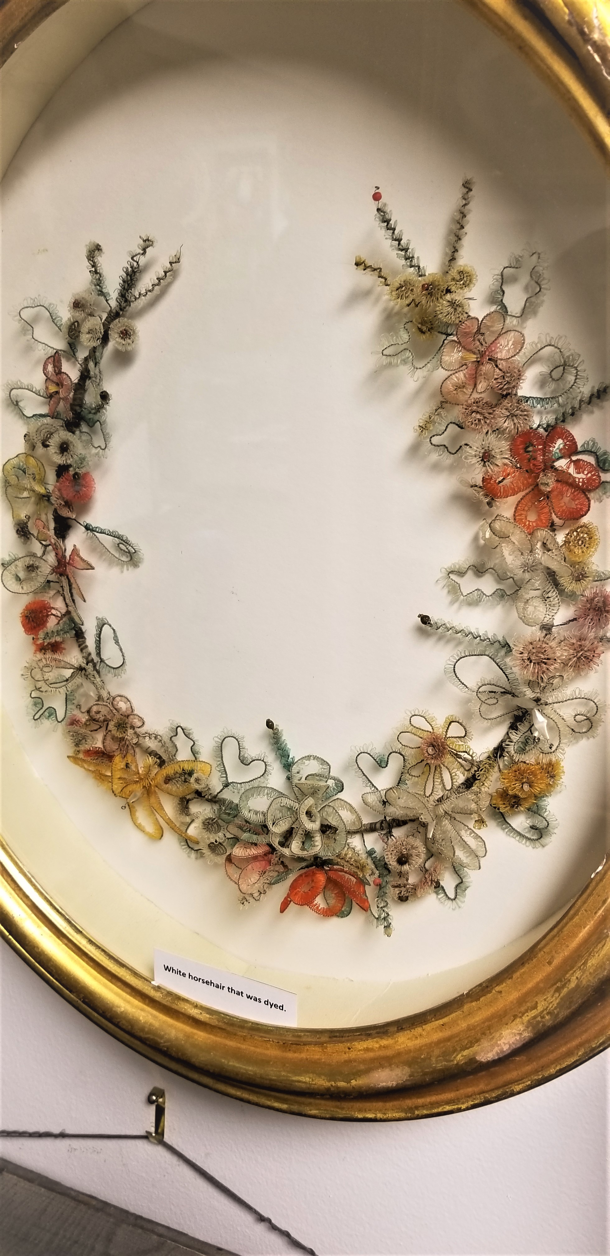 This hair art necklace has a floral themed design.jpg