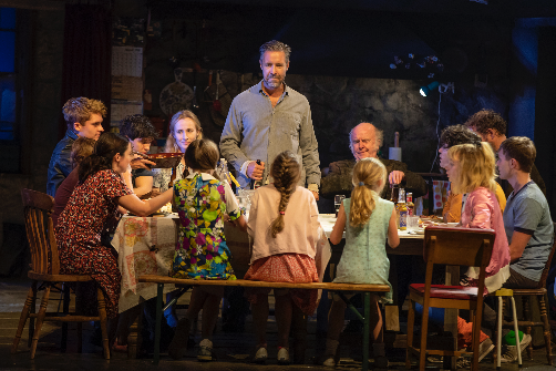 Paddy Considine (center, standing) and the ensemble of The Ferryman. Photo by Joan Marcus.