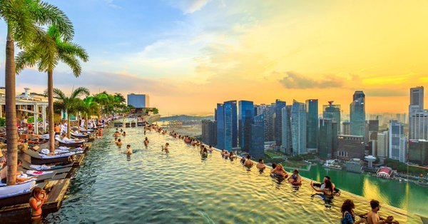 20 Hot Destinations You Can Visit for Less than $100 a Day. Pictured Singapore