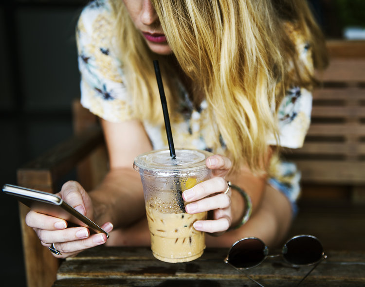 Woman drink and phone.jpg