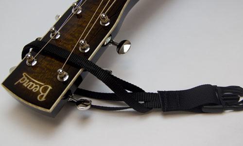 3) Put clip end through the loop.