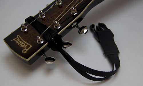 4) Gently tighten the loop until it is snug on headstock.