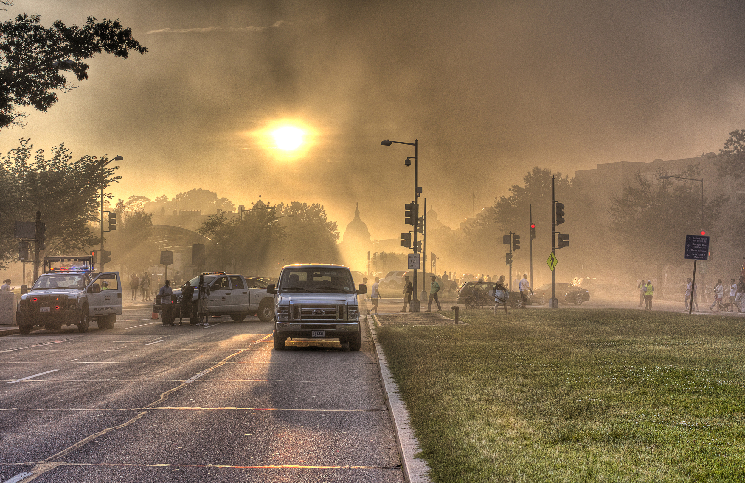 I decided to shoot the HDR because the sun coming through the smoke would give this amazing post-apocalyptic effect with both the cars a people moving.
