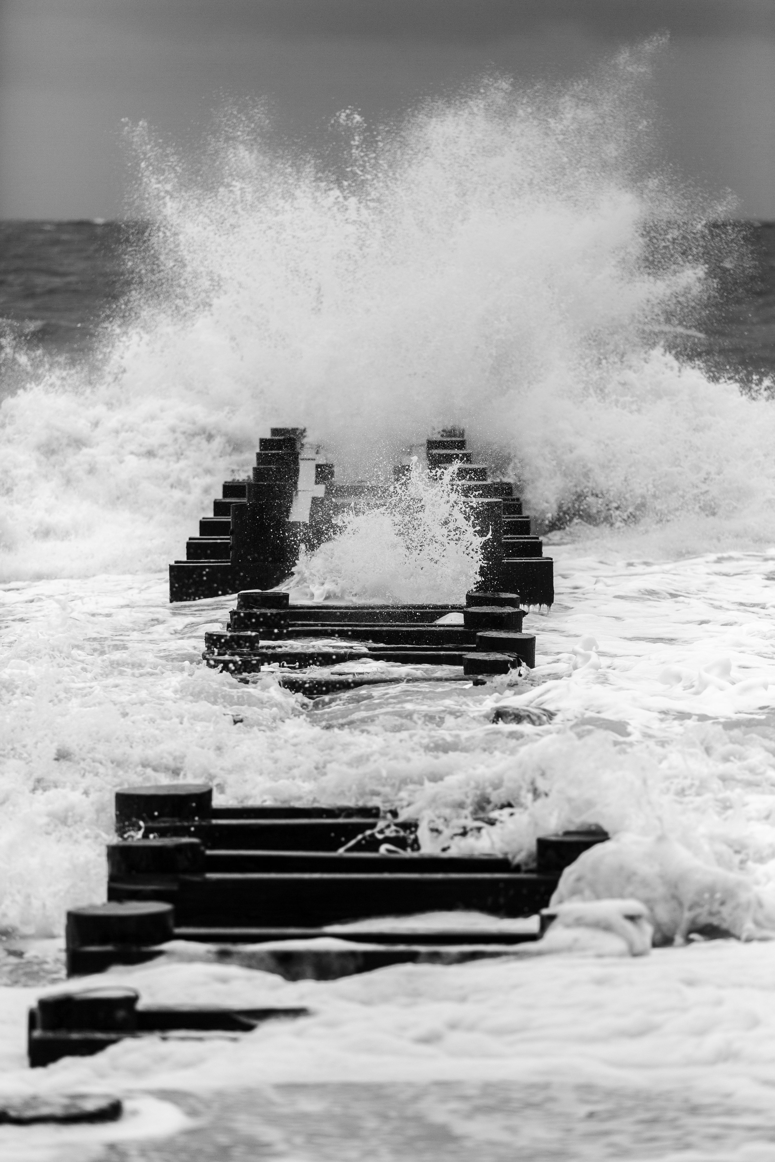 Waves crashing along one of the Jetties