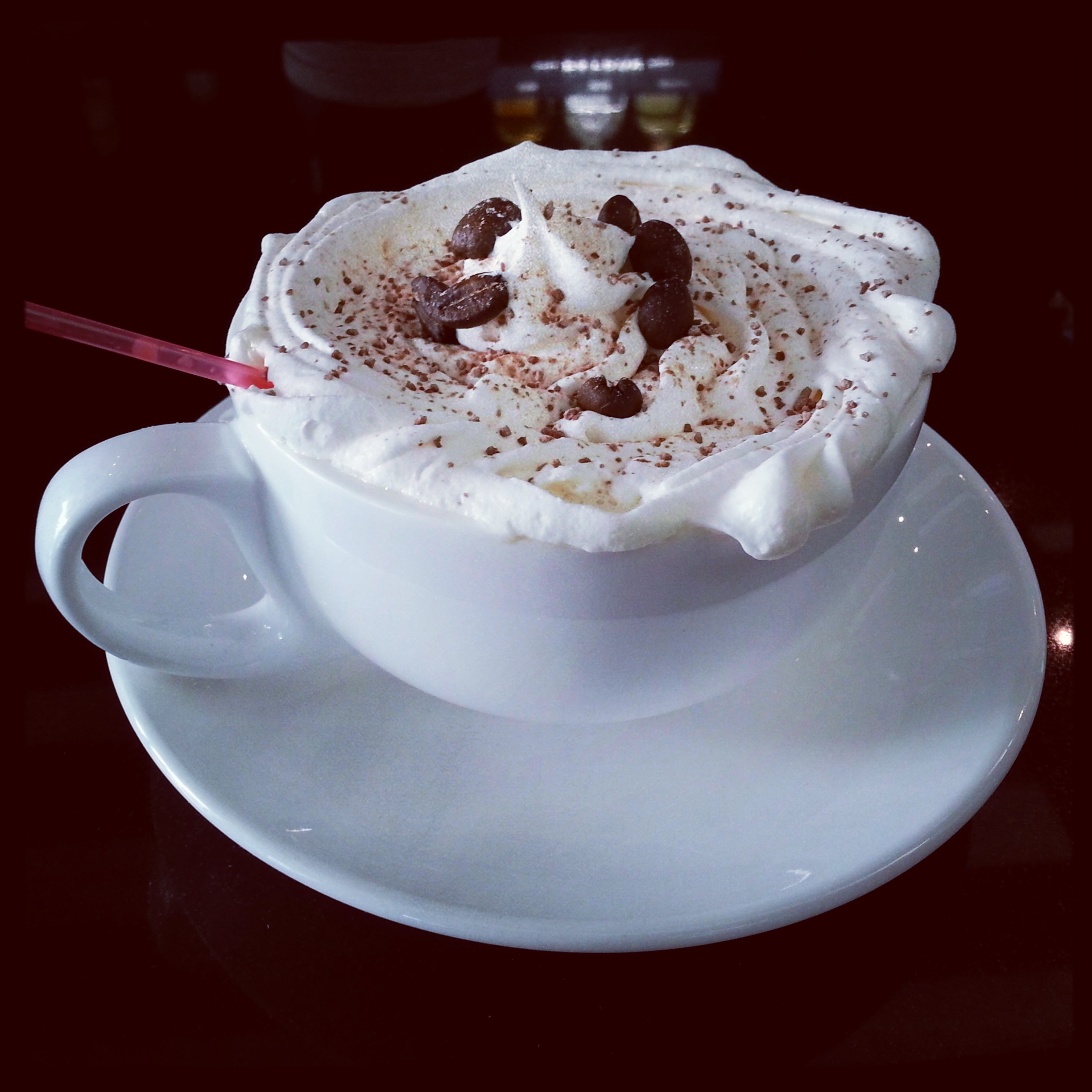 Hot Mexican Coffee topped with whipped cream, cinnamon and coffee beans. Yum!