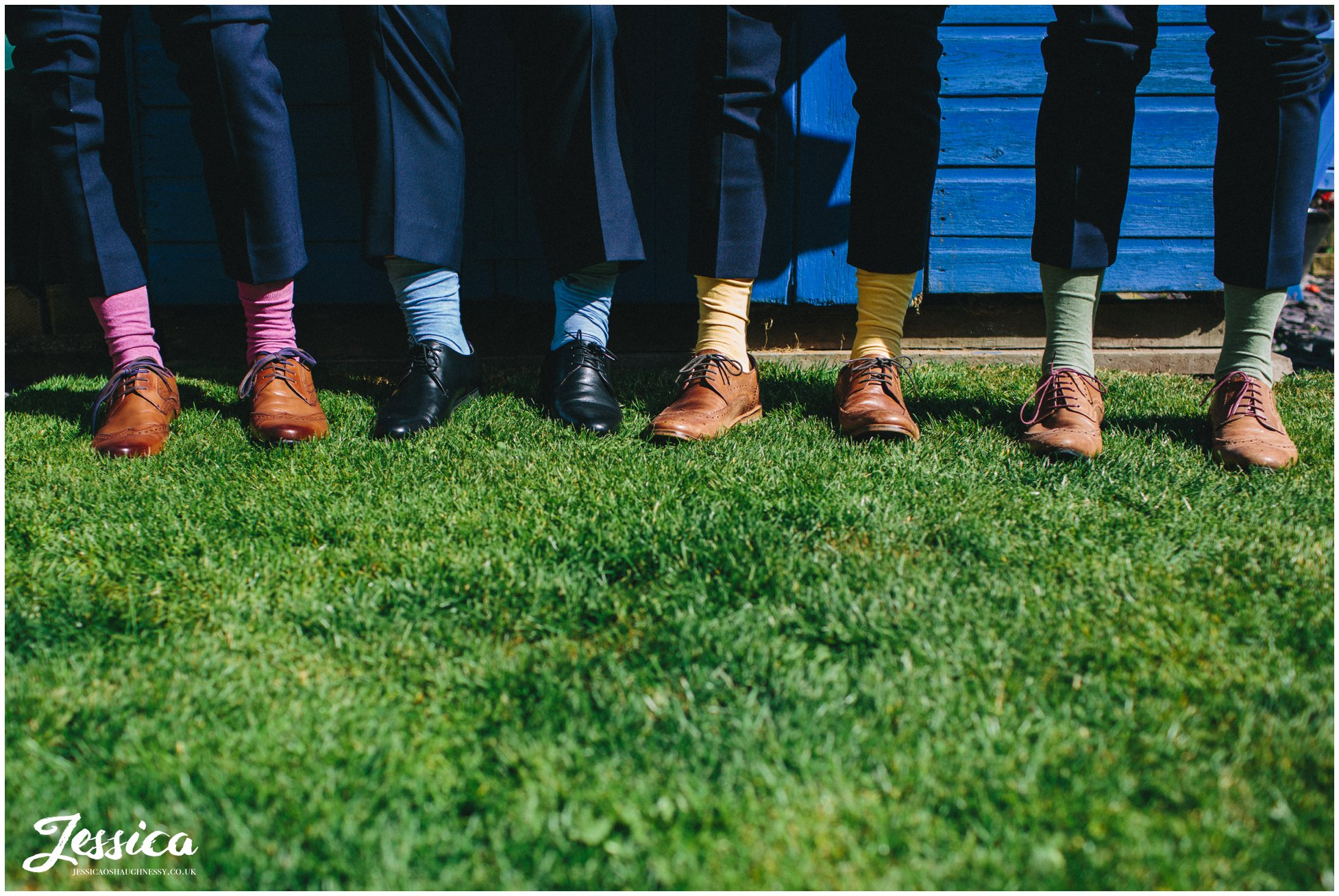 close up of groomsmens feet wearing multi coloured socks - wedding photographer