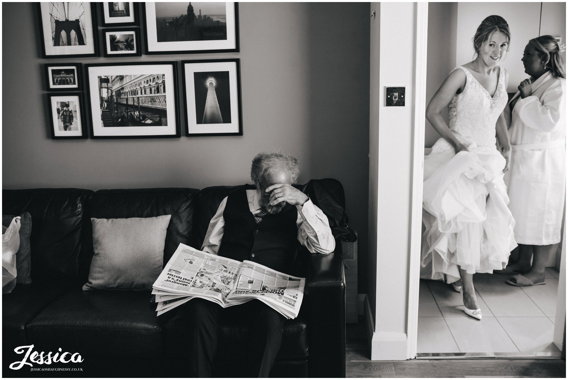 father of the bride reads a newspaper on the morning of the wedding day in north wales