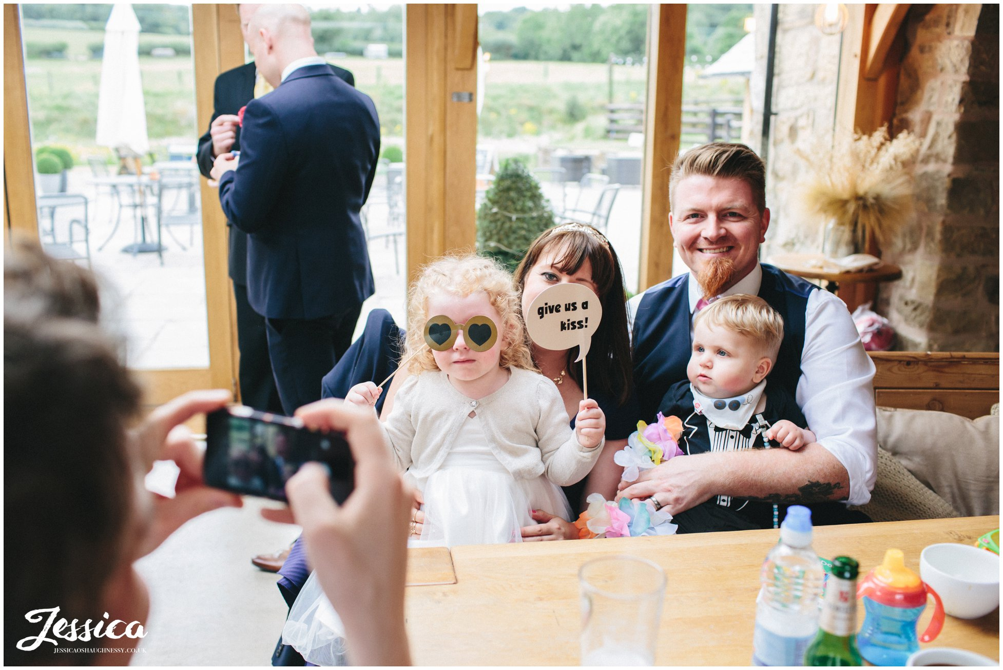family pose for a photograph during the wedding reception at a north wales wedding