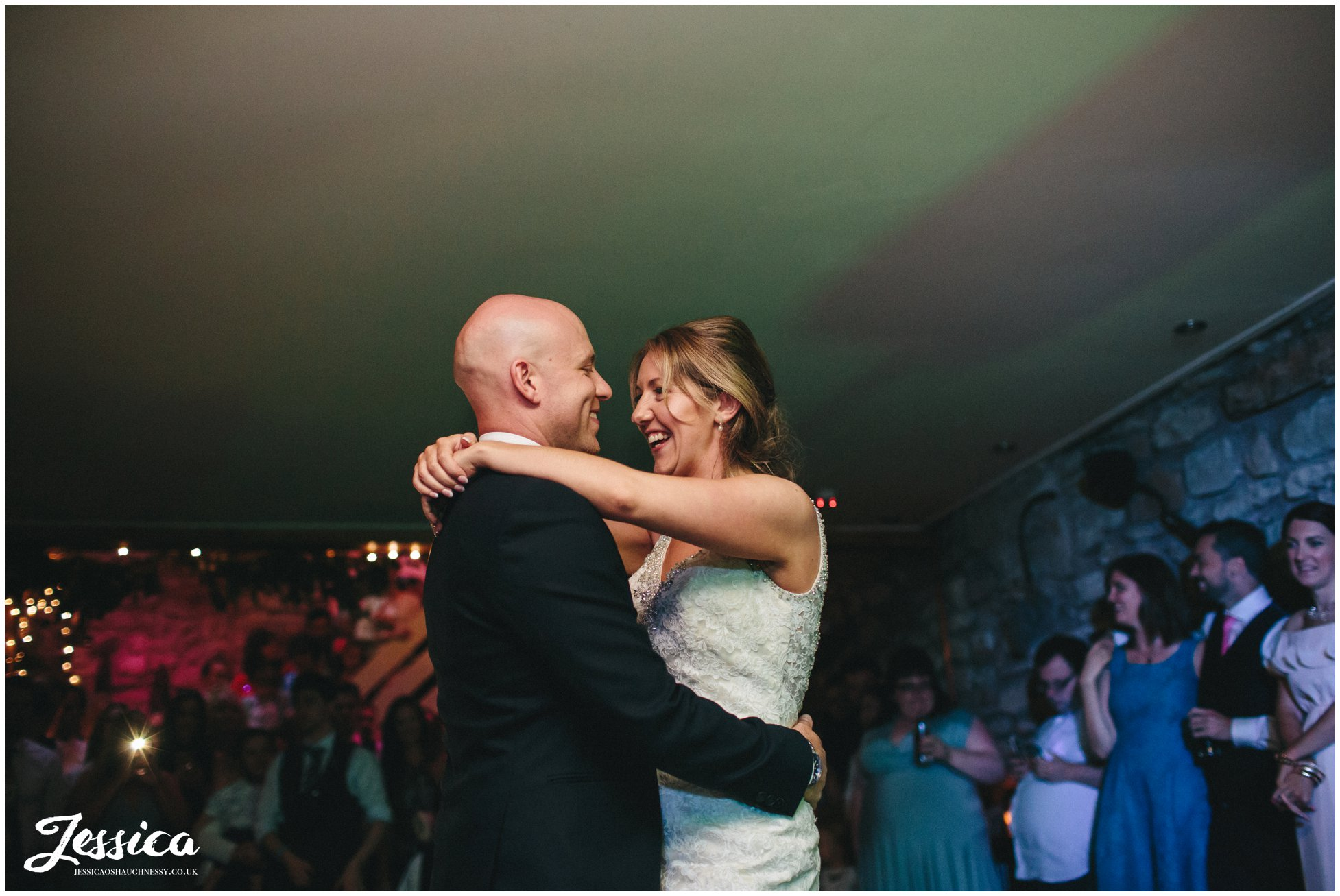 bride & groom sharing their first dance in 'the build' - tower hill barns in north wales