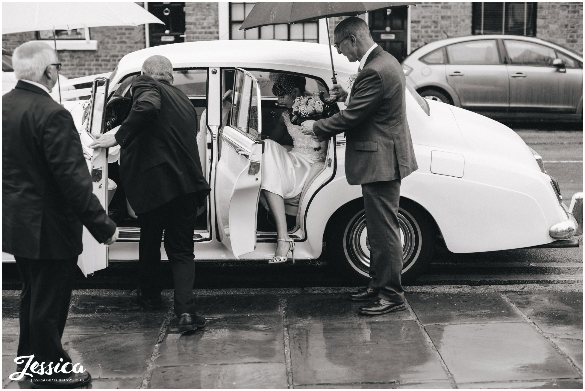 bride arrives at st mary's church for her wedding in chester