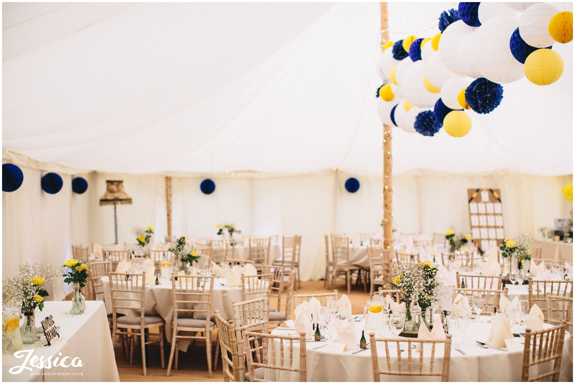 wedding breakfast marquee decorated ready for guests at a trafford hall wedding in chester