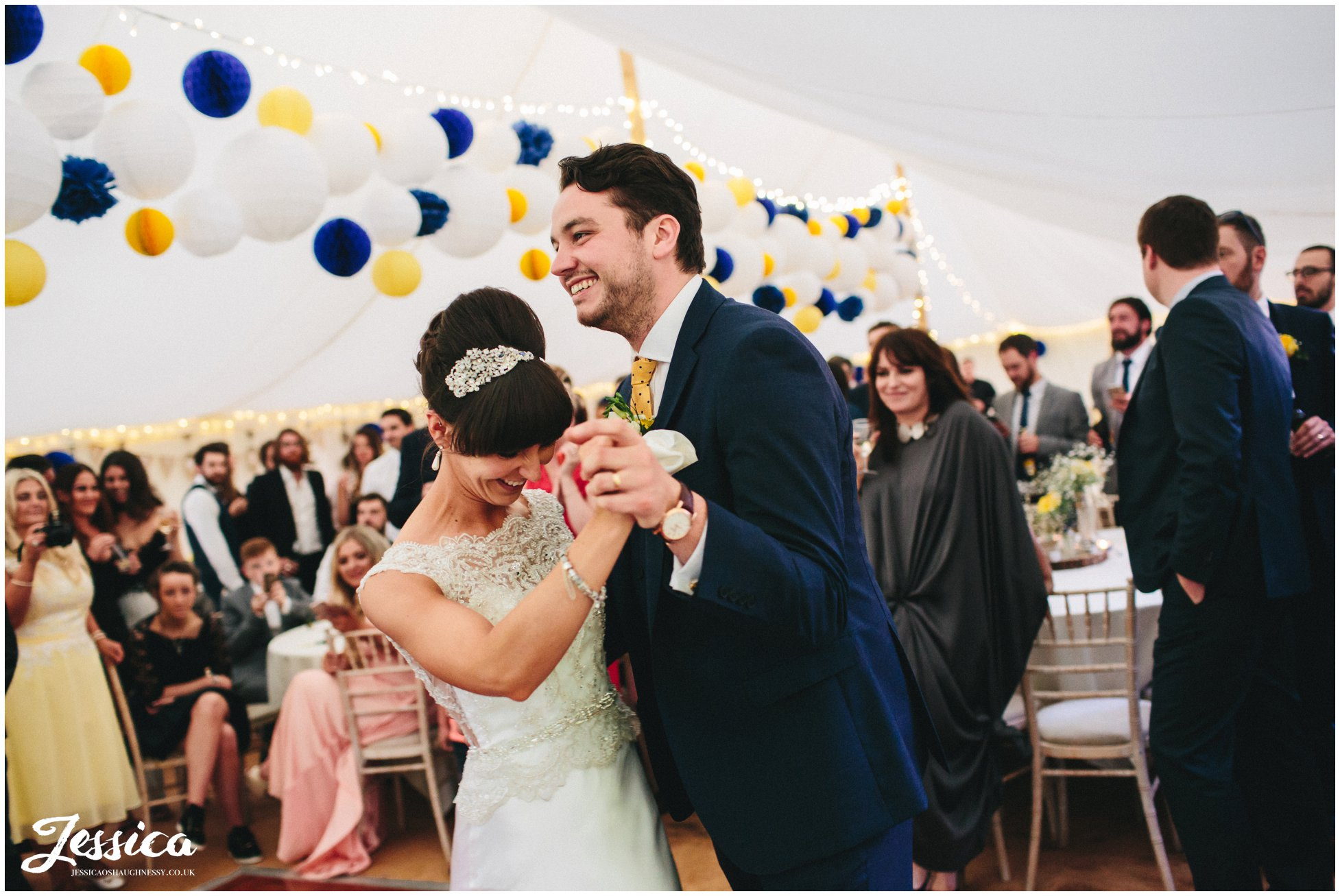 bride & groom share first dance in the marquee at trafford hall, chester