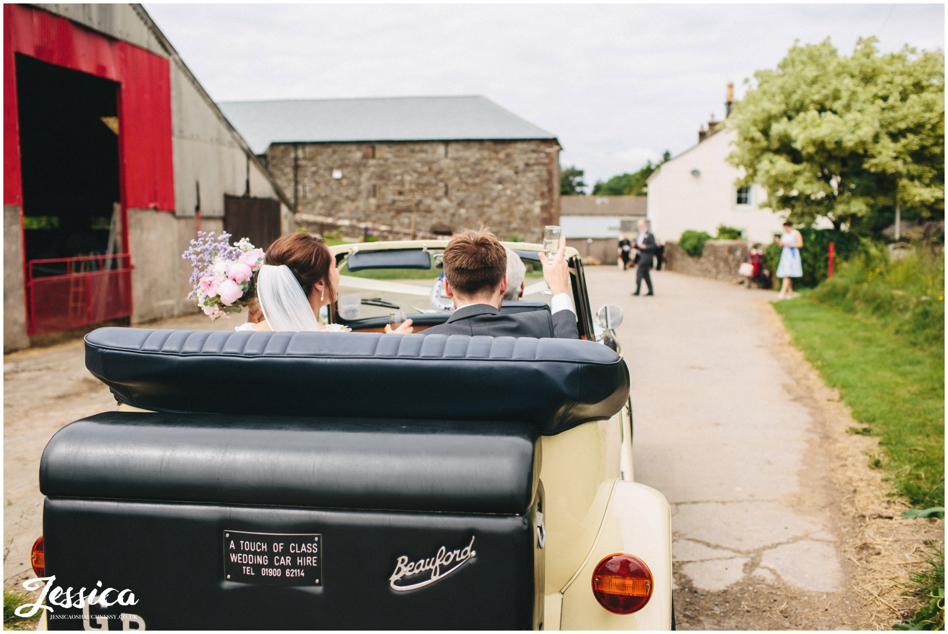 bride & groom arrive in car at three hills barn in torpenhow, cumbria wedding photographer