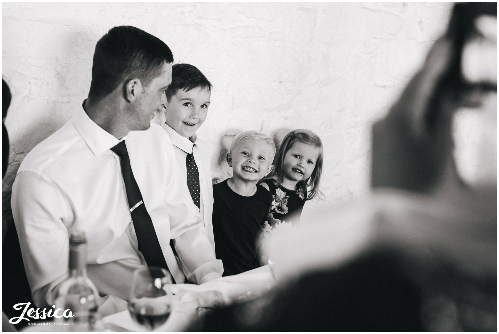 children pose for a photograph at an askham hall wedding