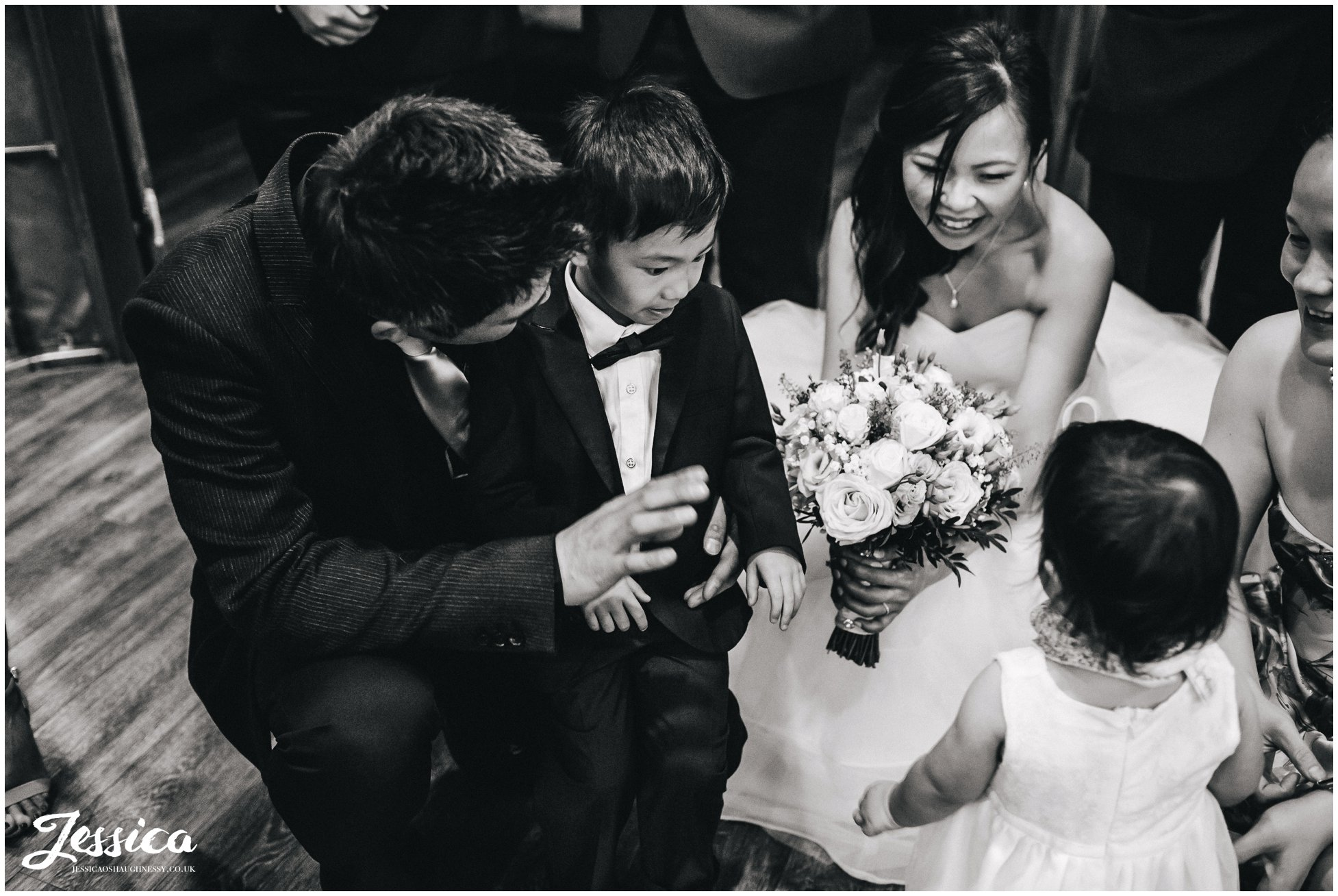newly wed's play with children at their wedding reception in salford, manchester