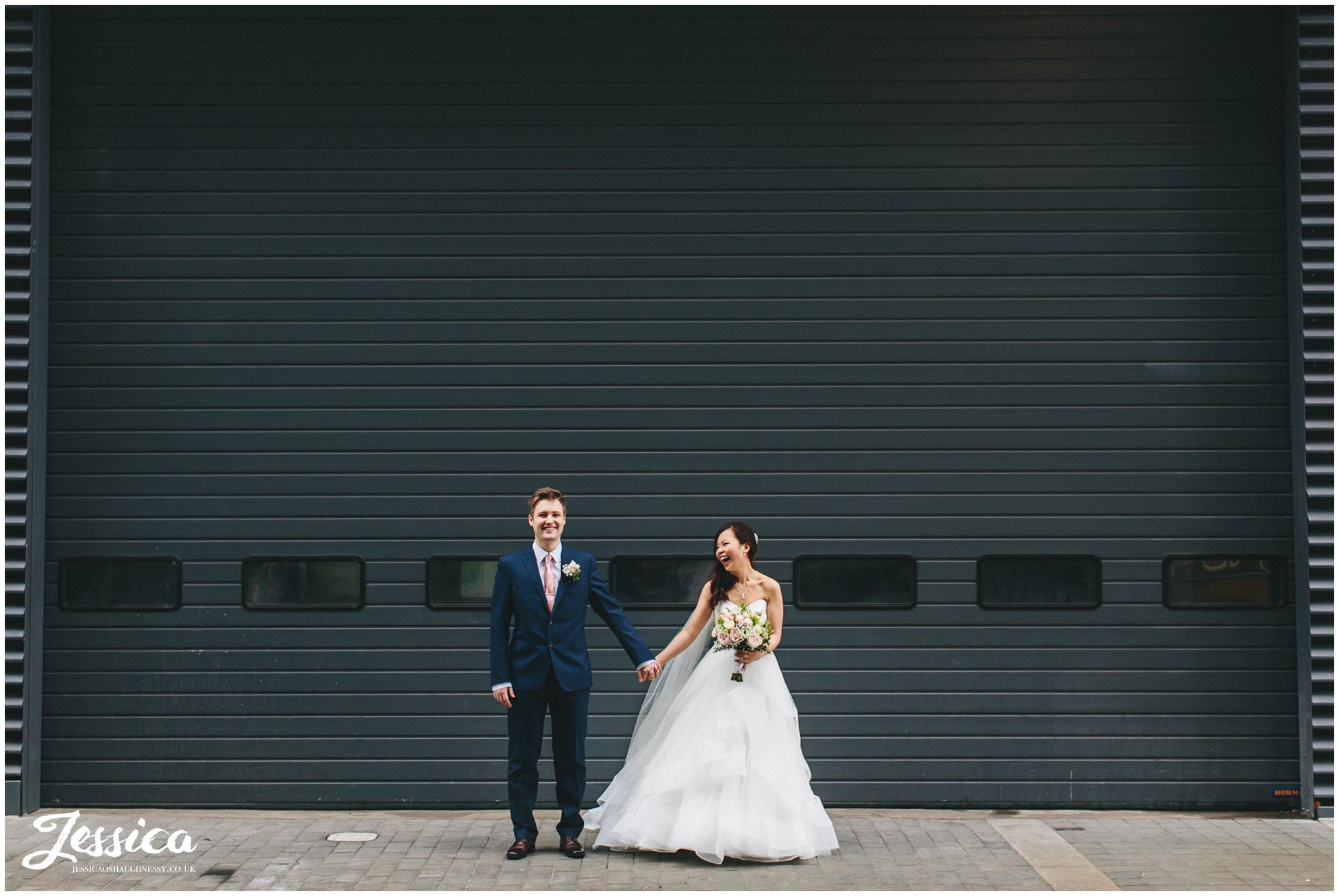 on the 7th wedding, manchester - bride & groom hold hands