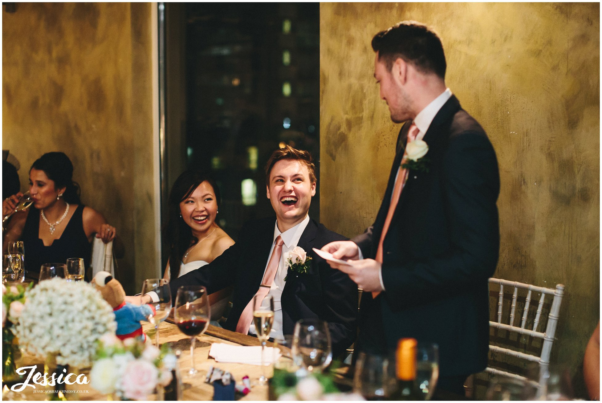 couple laugh during the best mans speech - salford wedding photography
