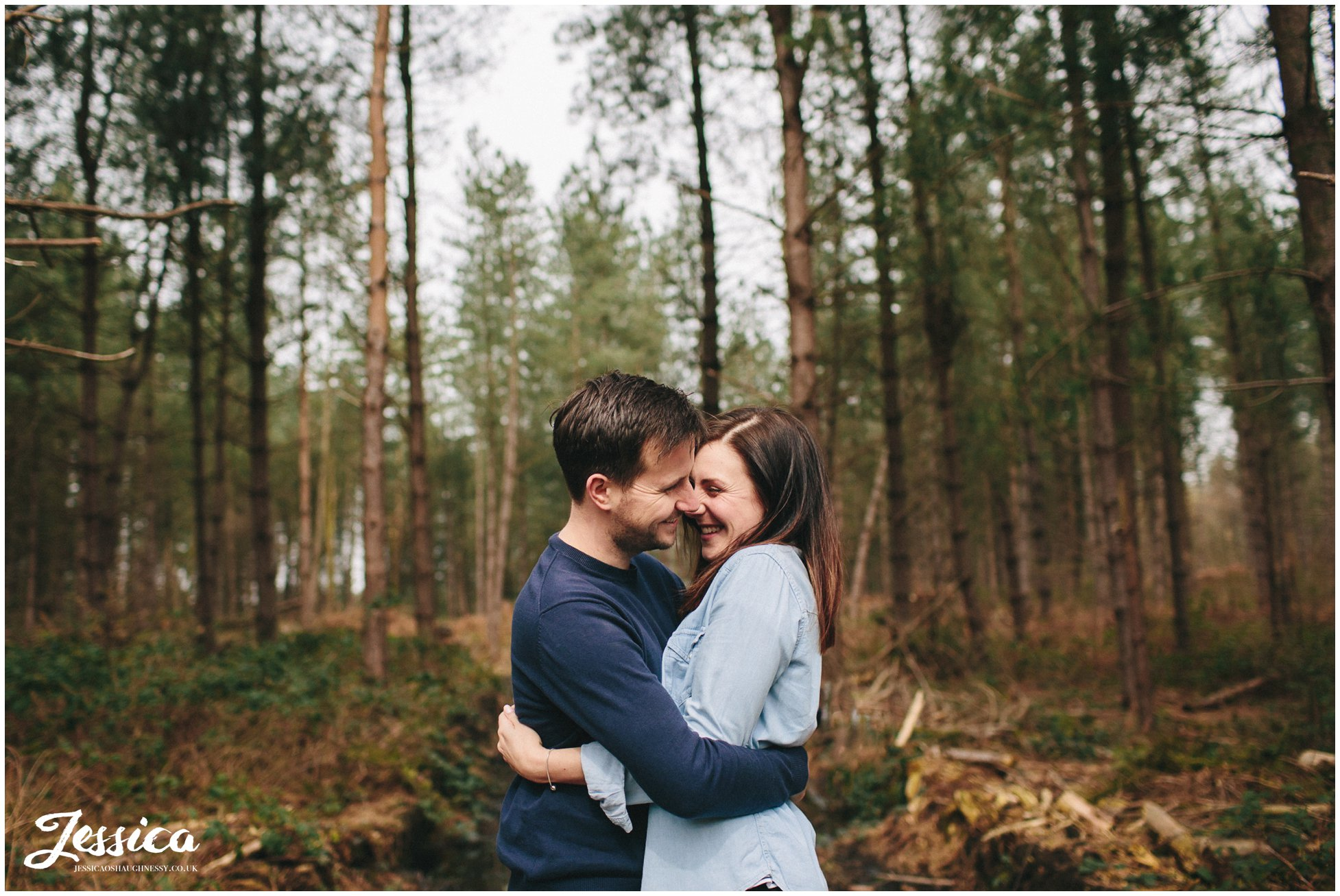 delamere forest - couple hugging and laughing during their engagement shoot