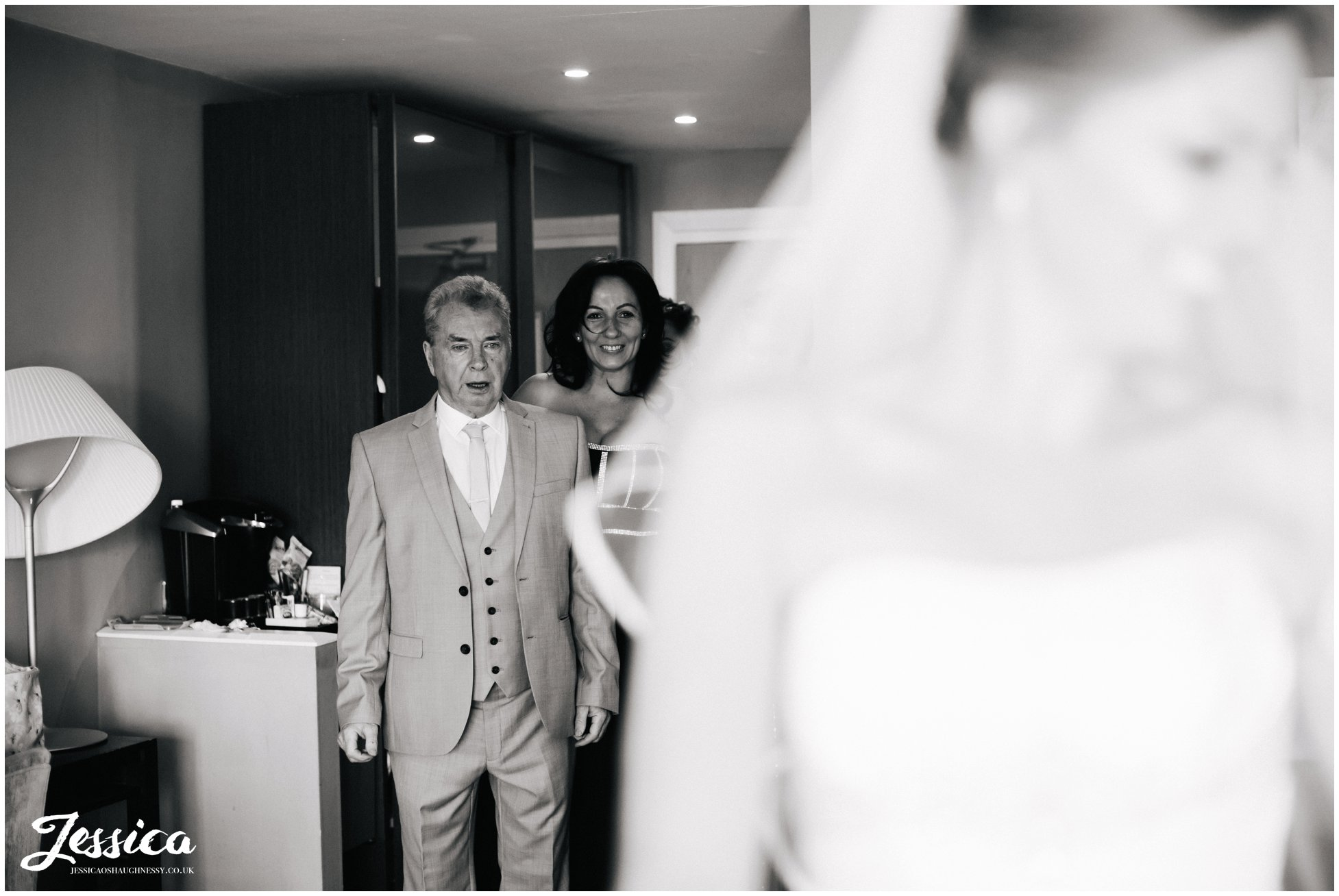 father of the bride in shock after seeing his daughter in her wedding dress - wirral wedding photographer