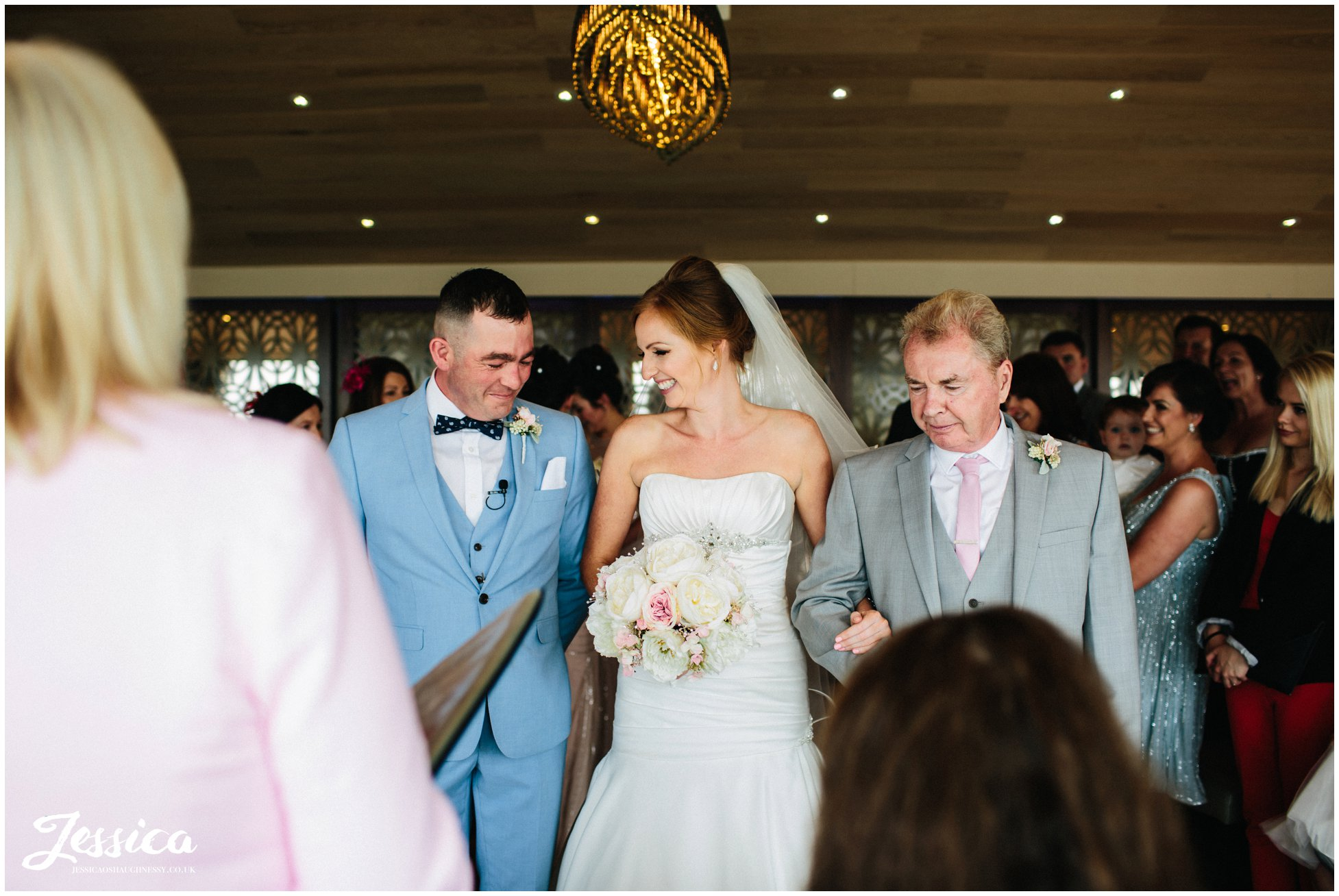 bride & groom meet eyes for the first time at their wedding on the wirral