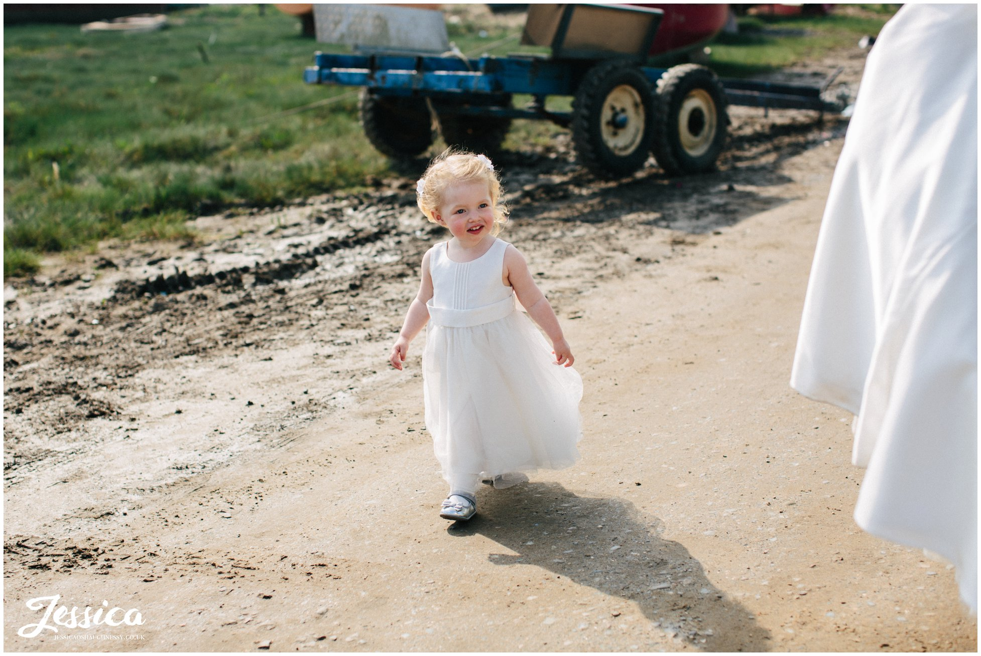 flower girl admire bride at a wedding at sheldrakes in heswall