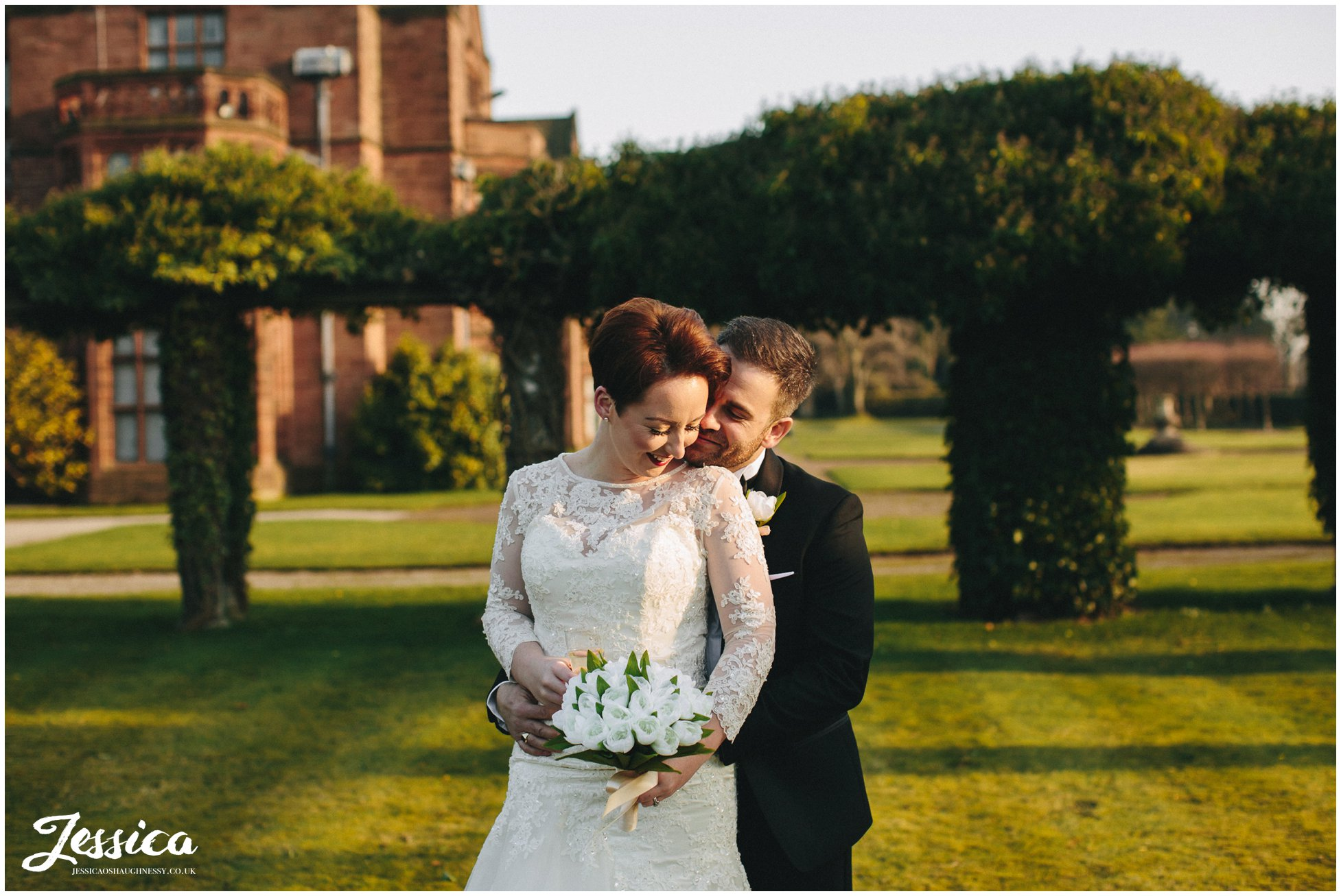 bride & groom basque in the sunlight on their wedding day at thornton manor