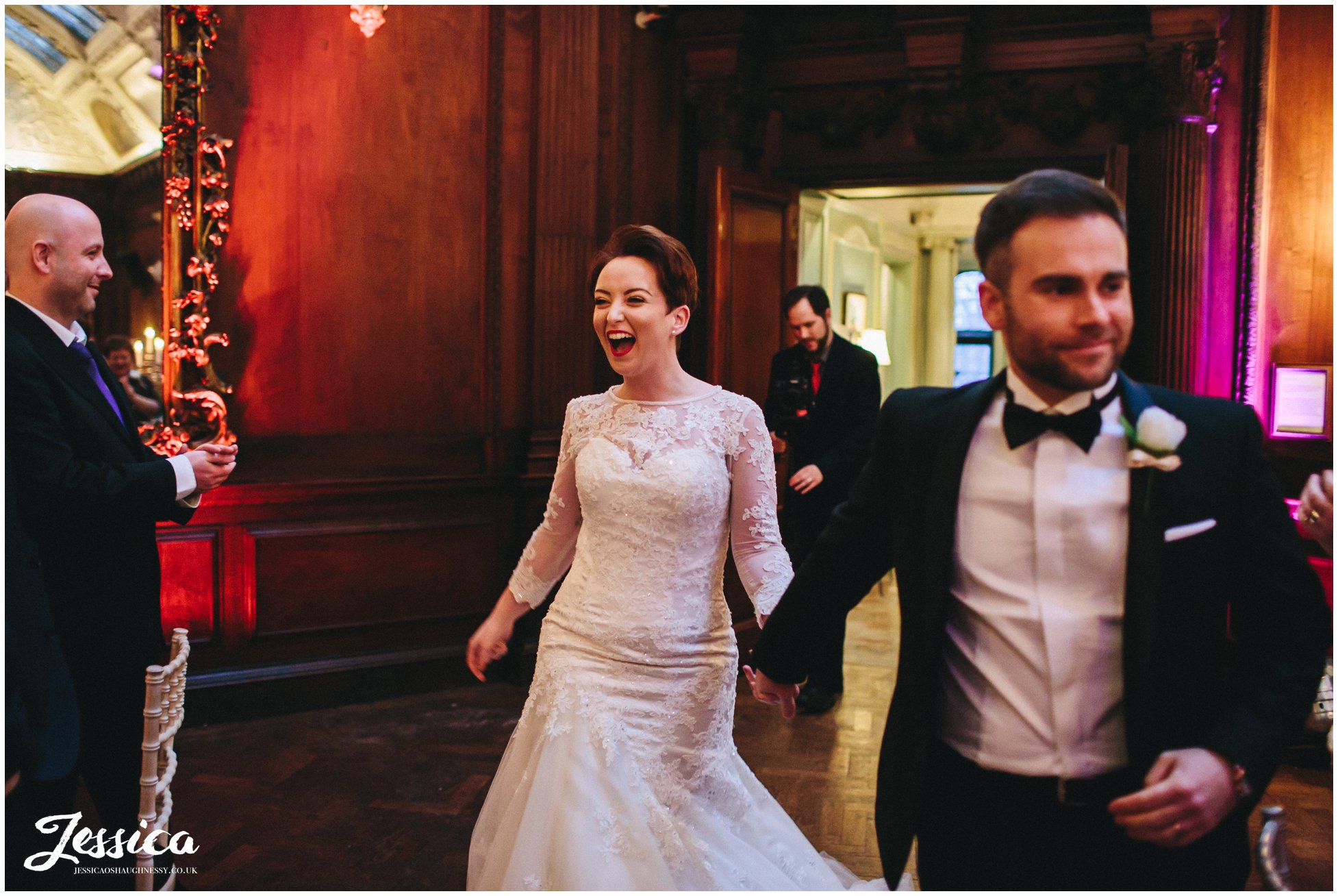 bride & groom are announced into their room in thornton manor