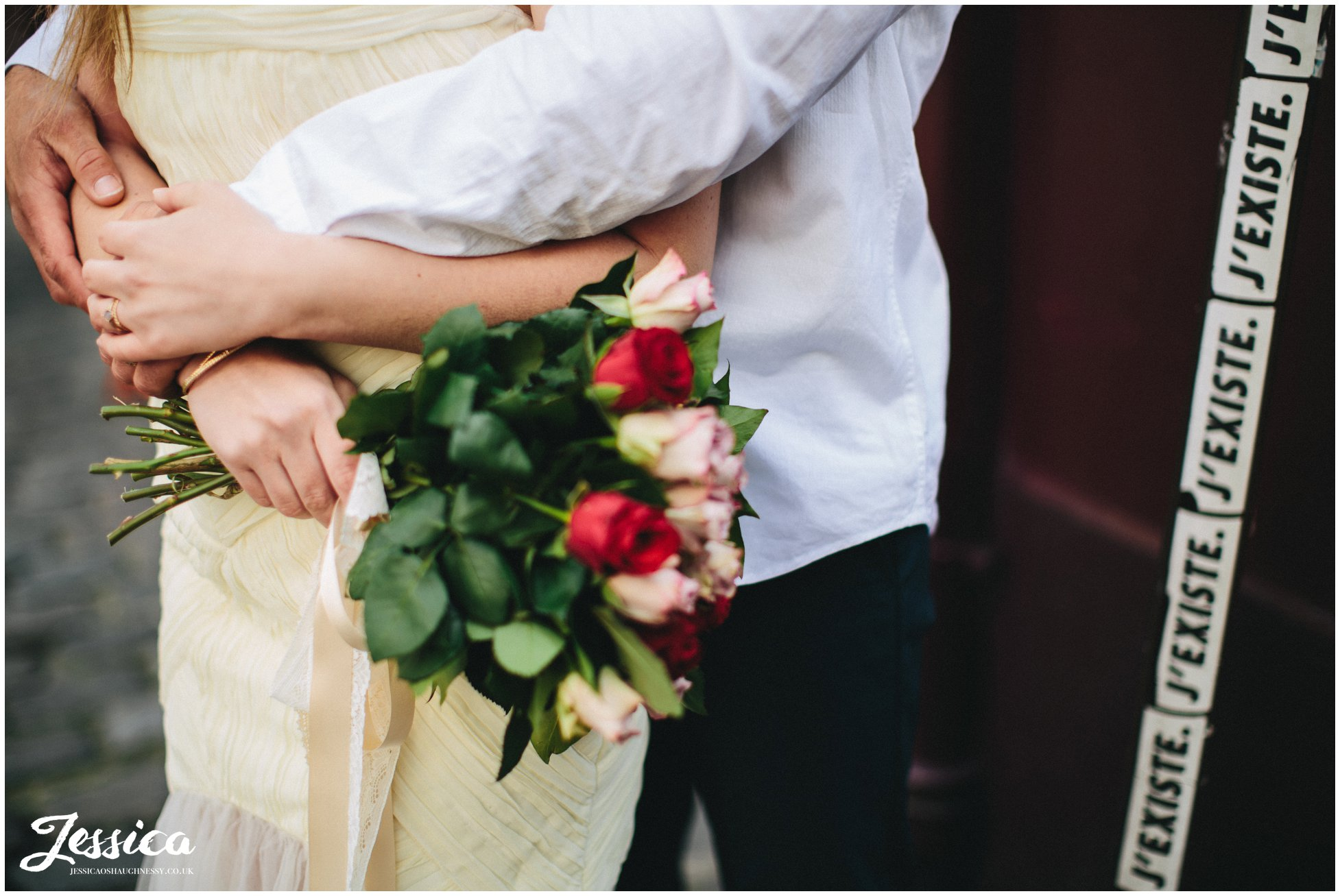 close up of bride holding her wedding bouquet in paris