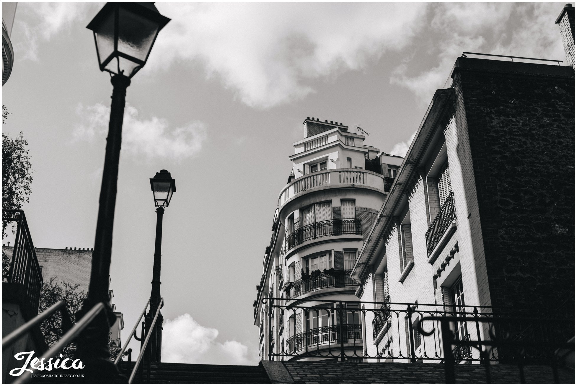 black and white photograph of parisian buildings