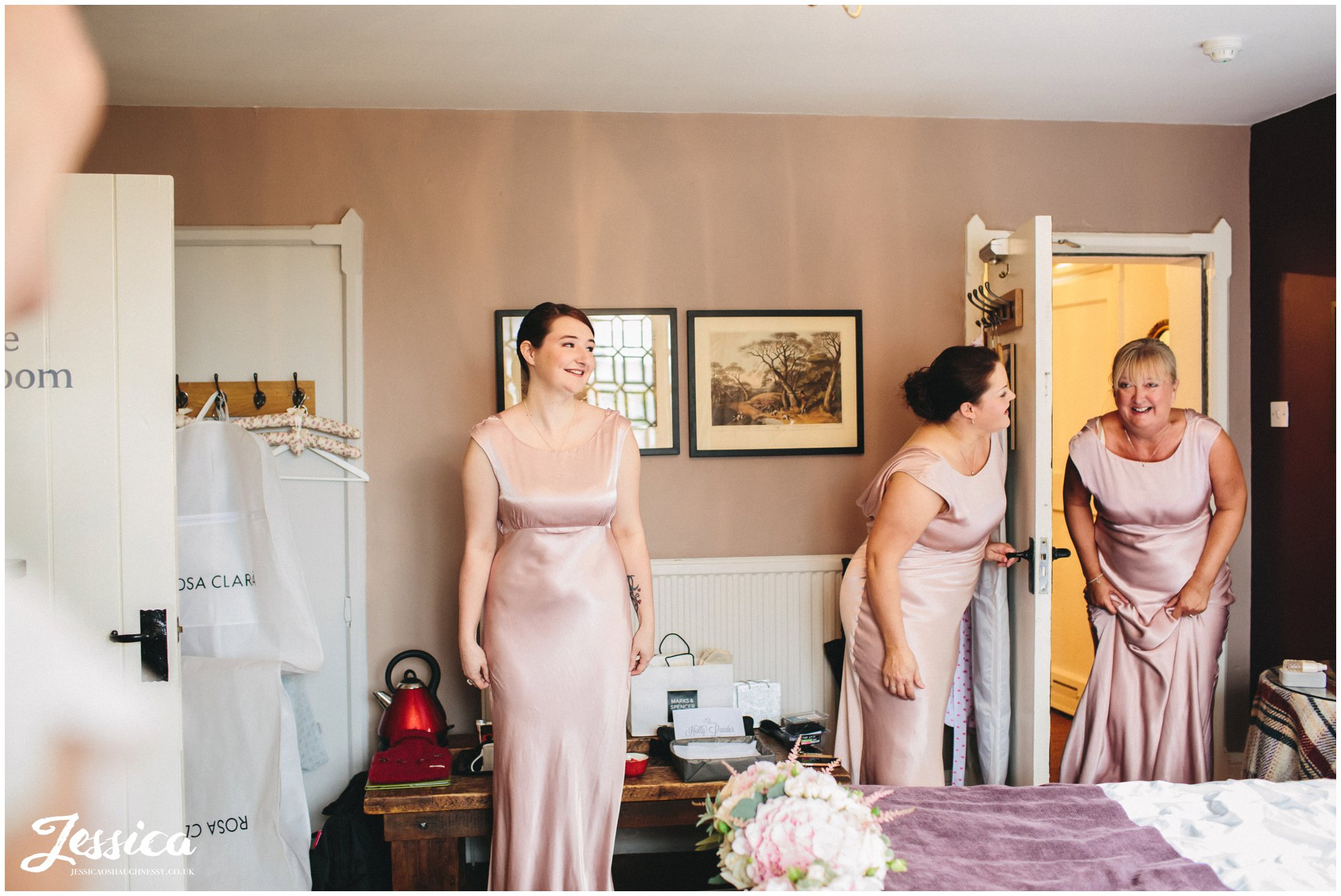 bridesmaids seeing the bride in her dress for the first time - cheshire wedding photographer