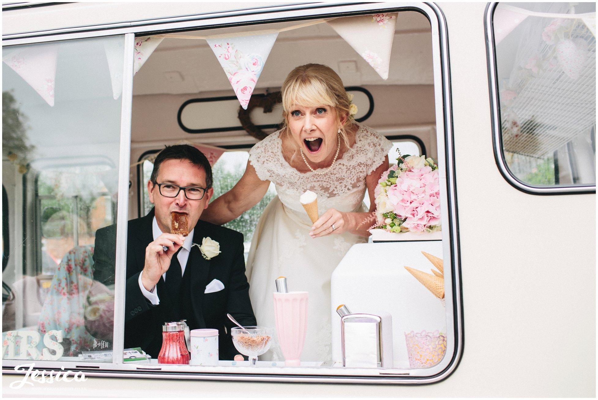 bride & groom eating ice-creams inside a vintage ice-cream van at their cholmondeley arms wedding