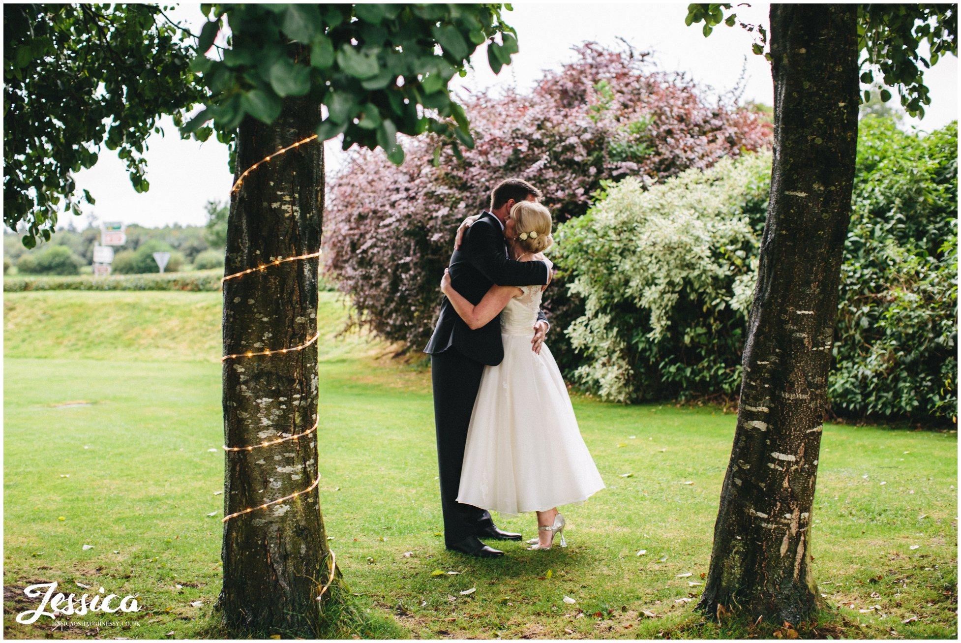 bride & groom hug on their wedding day at the cholmondeley arms