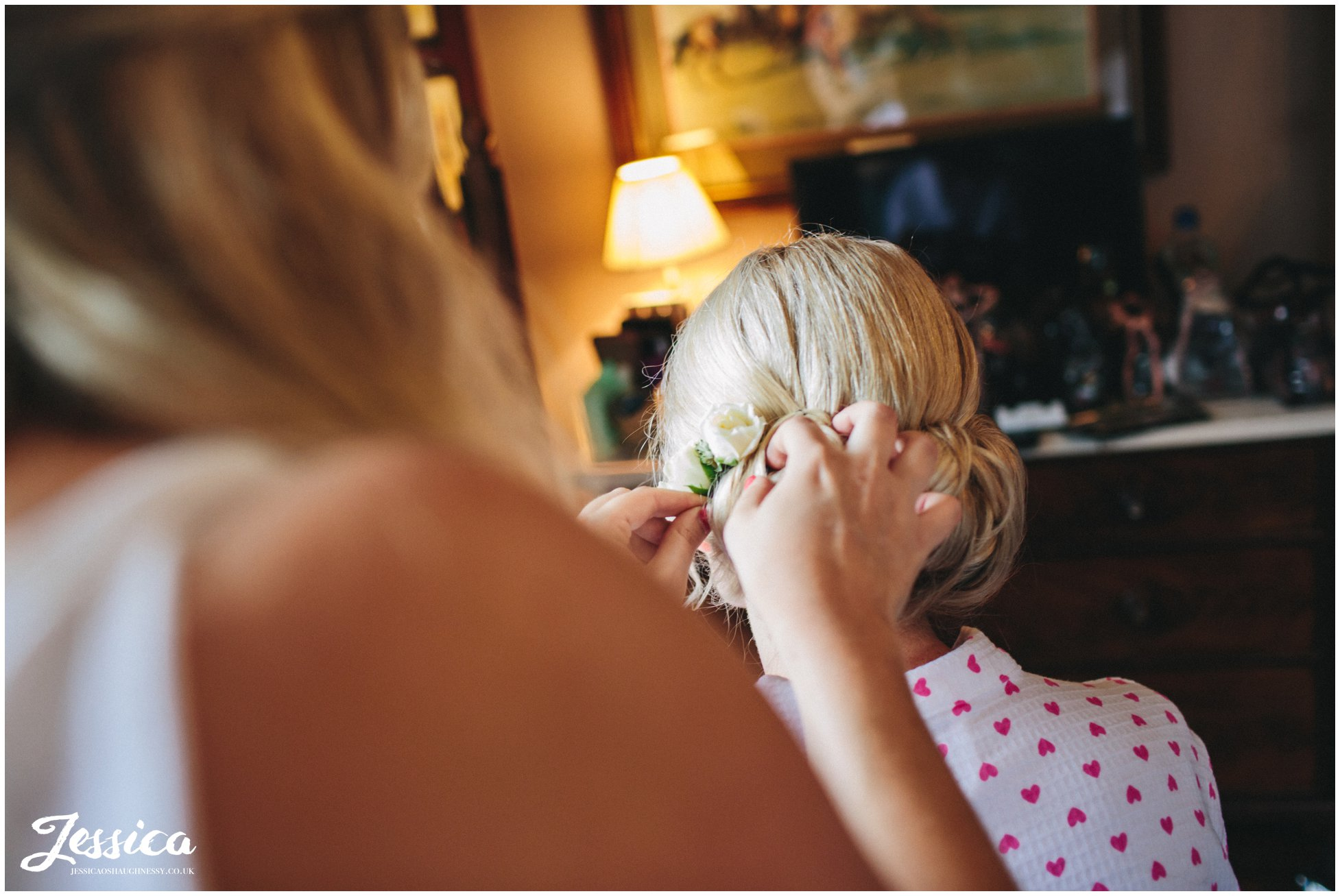 the bride getting her hair done on her wedding day